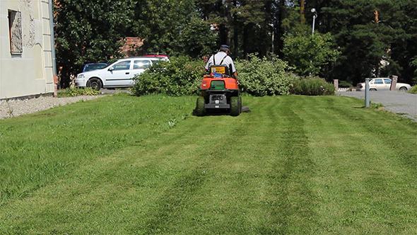 VideoHive Gardener Mowing the Lawn 5536611