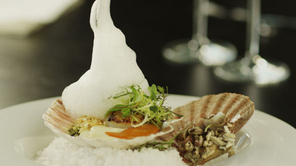 Chef Serving Shellfish with Foam