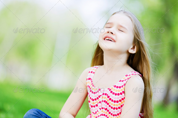 Little girl in park - Stock Photo - Images
