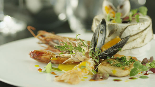 VideoHive Chef Garnishing Delicious Selection of Seafood 5567574