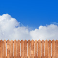 Wood picket fence with blue sky - PhotoDune Item for Sale