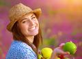 Beautiful female offers an apple - PhotoDune Item for Sale