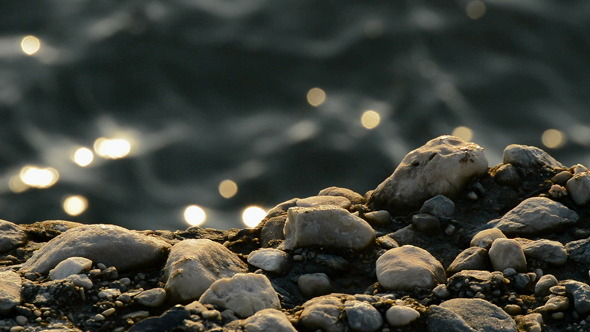 Stones on Sea Rocks at Sunset