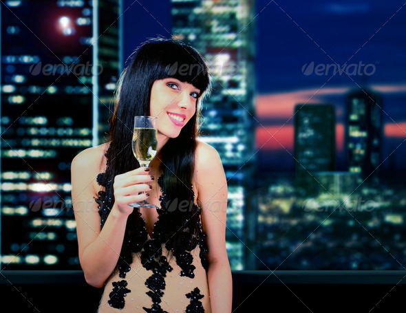 Happy woman with champagne glass - Stock Photo - Images