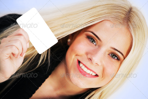 Woman holding a blank card - Stock Photo - Images