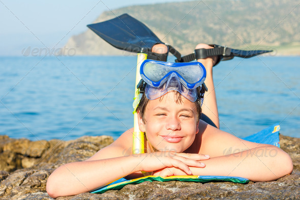 Happy young diver on the sea beach - Stock Photo - Images