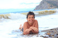 Happy smiling boy on the sea beach - PhotoDune Item for Sale