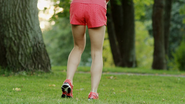 VideoHive Girl Warms Up and Stretches Before Running 5630036