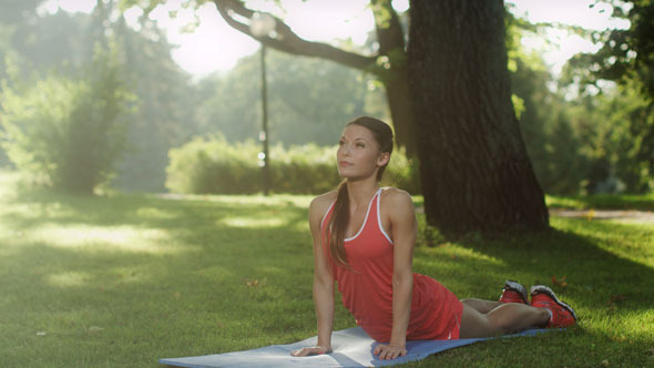 VideoHive Girl Doing Yoga in Park 5630524