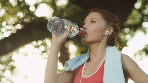Girl Drinking Water During Sport Training 4K