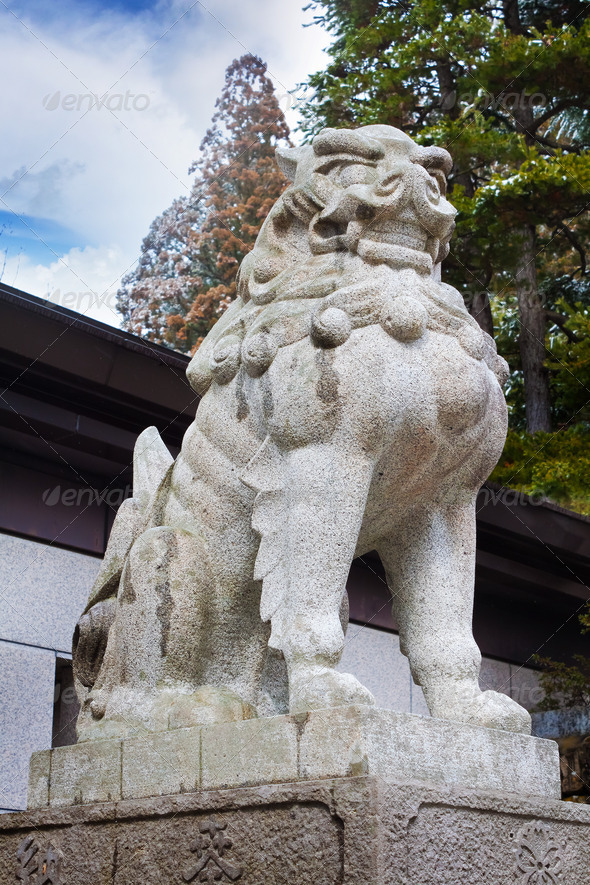 Stone lion sculpture in front of Sakurayama Hachimangu Shrine in Hida - Takayama
