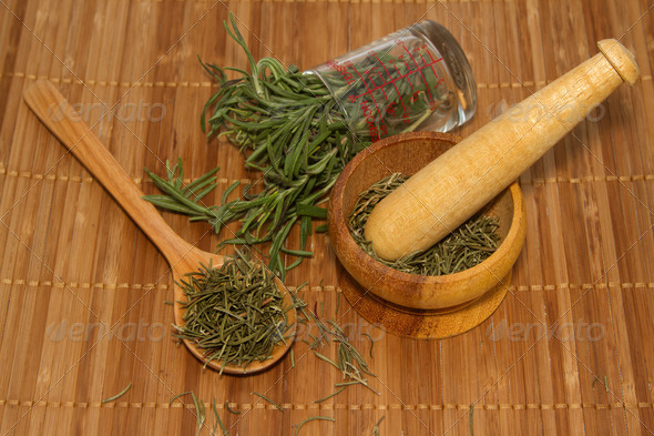 Rosemary product, mortar with fresh and dried rosemary