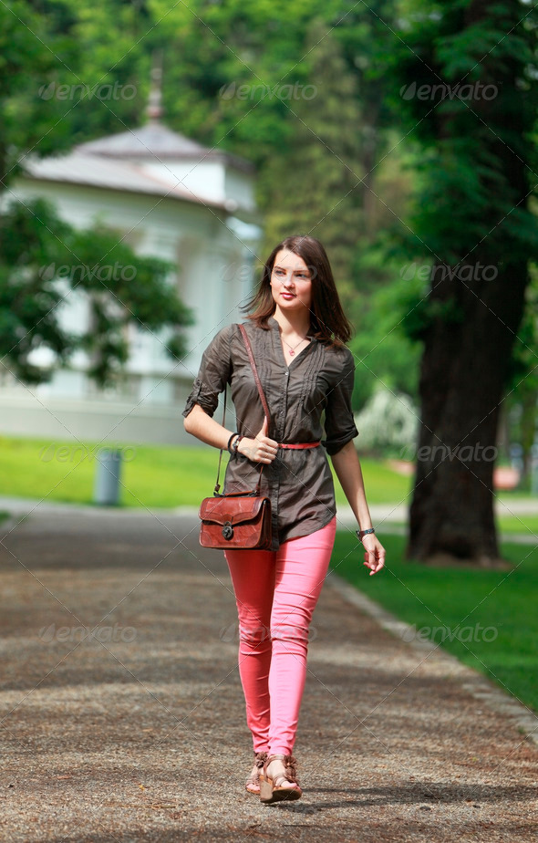 Young Woman Walking in a Park  - Stock Photo - Images