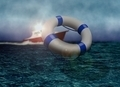 Rescue Boat and Life Buoy at Sea during Stormy Day