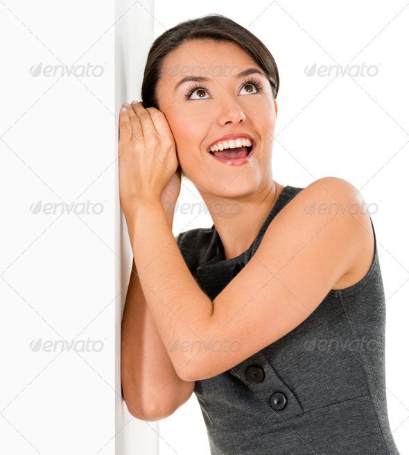 Woman listening behind walls - Stock Photo - Images