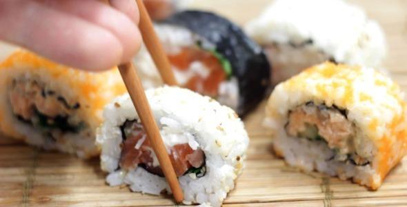 Eating Sushi Maki Rolls