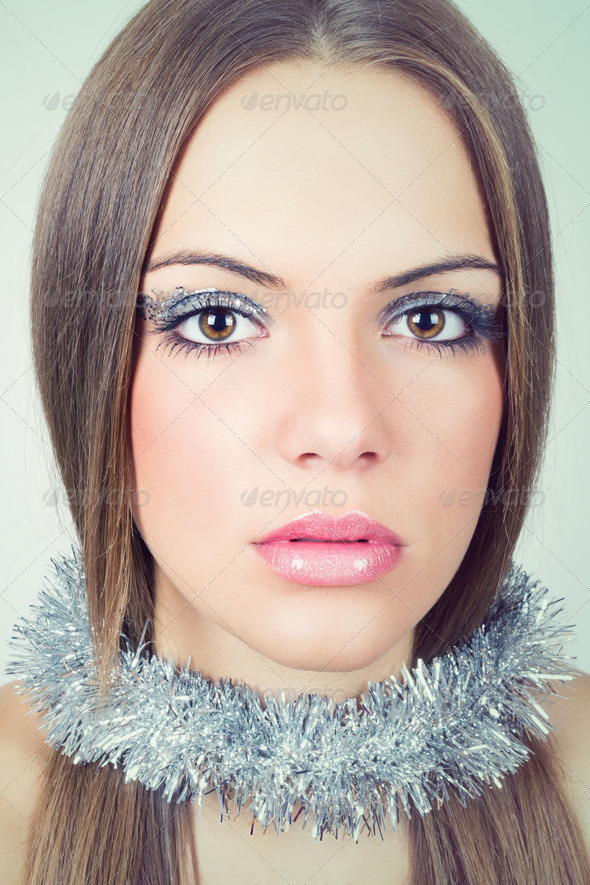 Beautiful young woman wearing glittery makeup - Stock Photo - Images