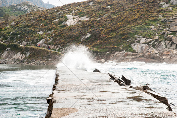 Waves over path at Cies island natural park, Galicia - Stock Photo - Images