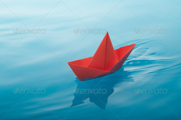 paper boat sailing - Stock Photo - Images