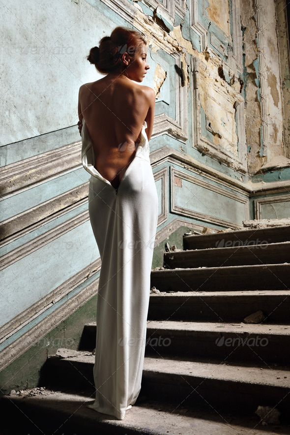 beautiful woman in white dress with naked back in palace. - Stock Photo - Images