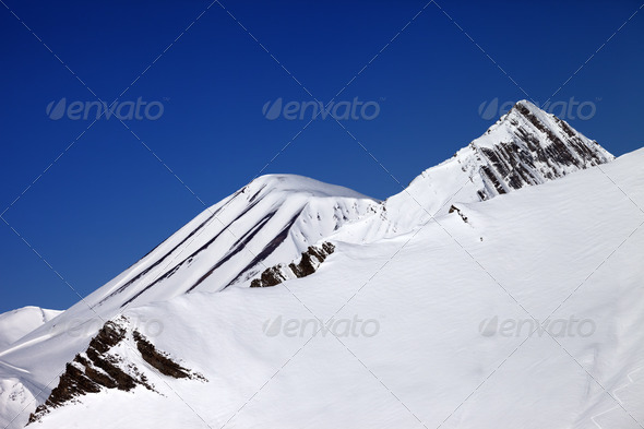 Off-piste slope and blue clear sky in nice day - Stock Photo - Images
