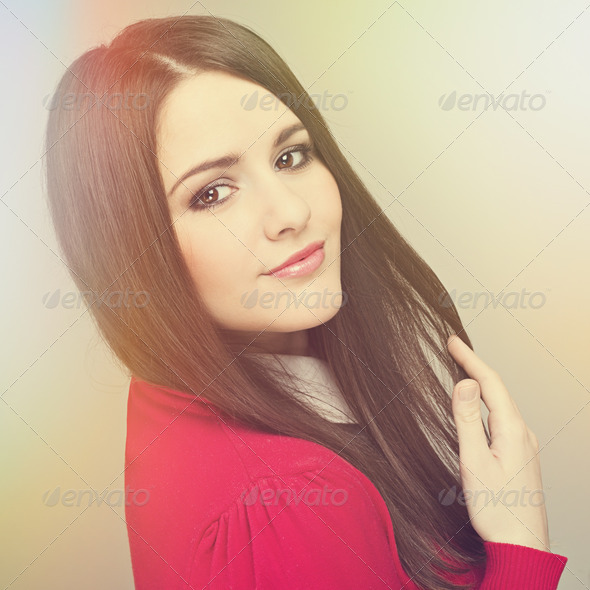 Beautiful young woma with straight brown hair posing - Stock Photo - Images