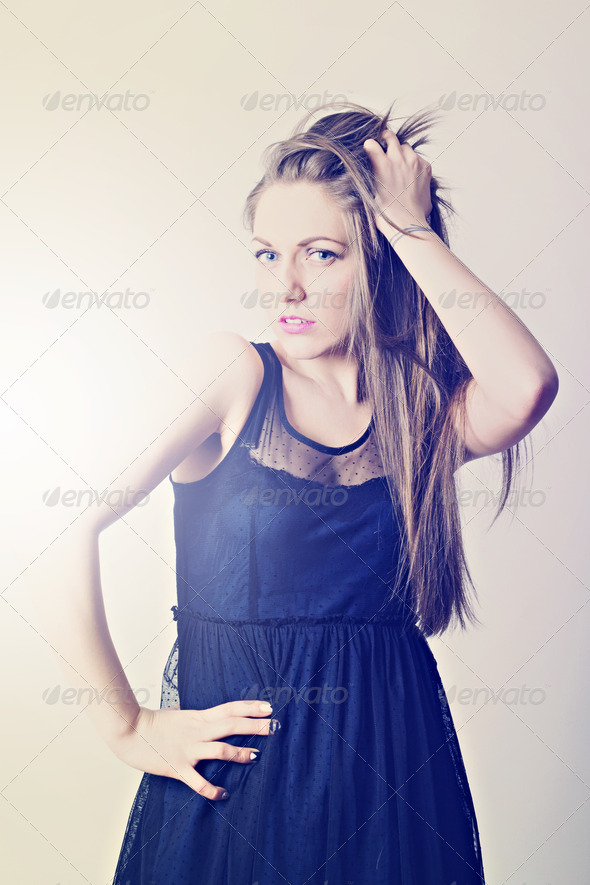 Attractive young woman wearing modern black dress  - Stock Photo - Images