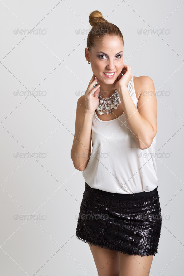 Fashionable young woman wearing big necklace posing - Stock Photo - Images