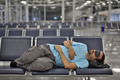 sleeping in airport with eye cover - PhotoDune Item for Sale