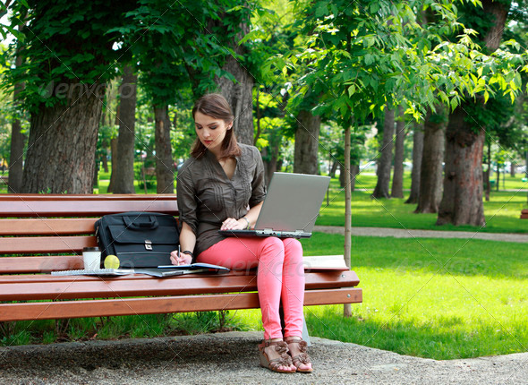 Young Woman Studying Outside in a Park  - Stock Photo - Images