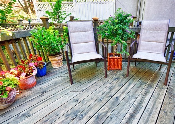 Chairs on wooden deck - Stock Photo - Images