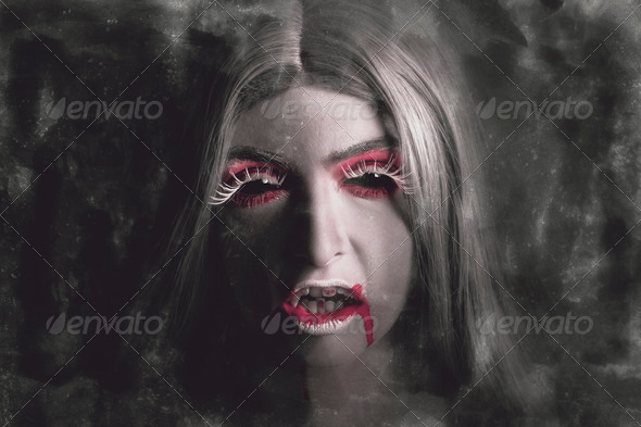 Sinister portrait of scary vampire woman - Stock Photo - Images