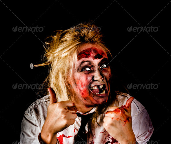 Undead business zombie giving Halloween thumbs up - Stock Photo - Images