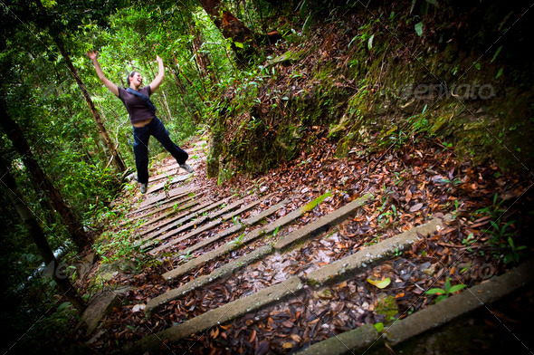 Leaping Jungle Hiker - Stock Photo - Images