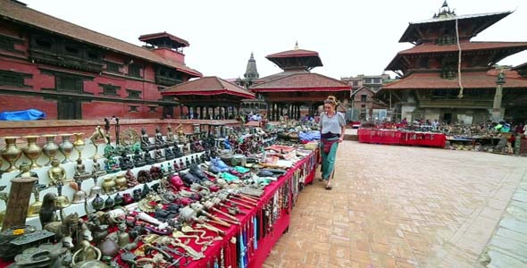 Female Tourist Choosing Souvenir 2