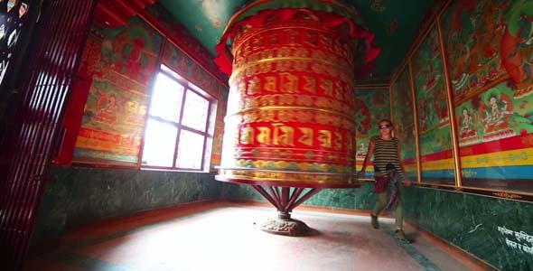 Tourist Girl At Prayer Wheel Kathmandu Nepal 2