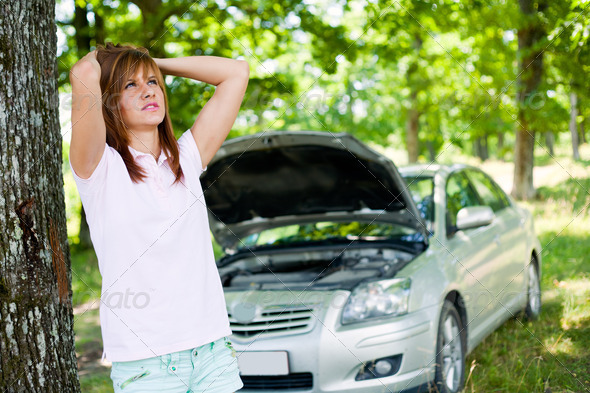 Woman with broken car - Stock Photo - Images