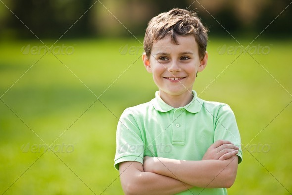 9 years old kid in a park - Stock Photo - Images