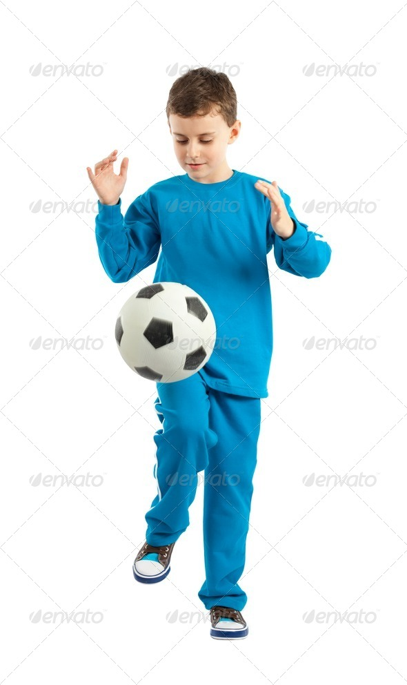 Boy executing a football kick - Stock Photo - Images