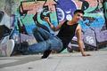 breakdance dancer on a city street