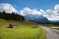 wooden hut on meadow and high Bavarian alps