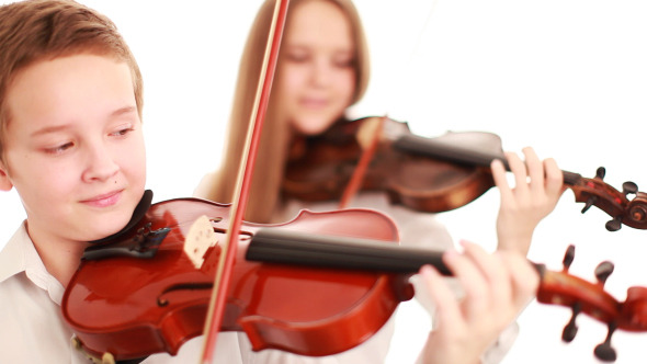 Two Teenager Playing the Violin