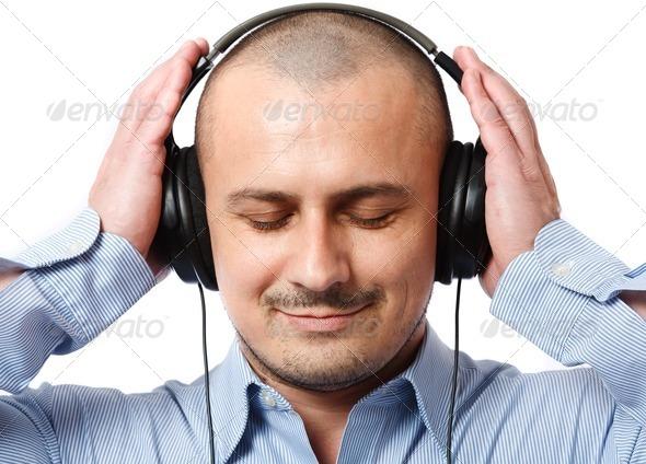 Businessman listening music - Stock Photo - Images