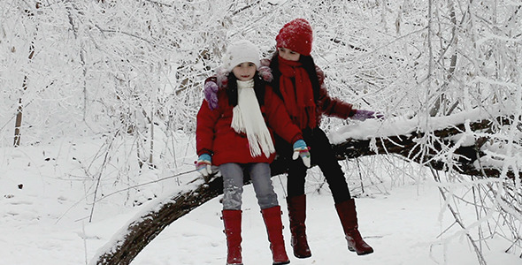 Girls Talking on a Tree in Winter
