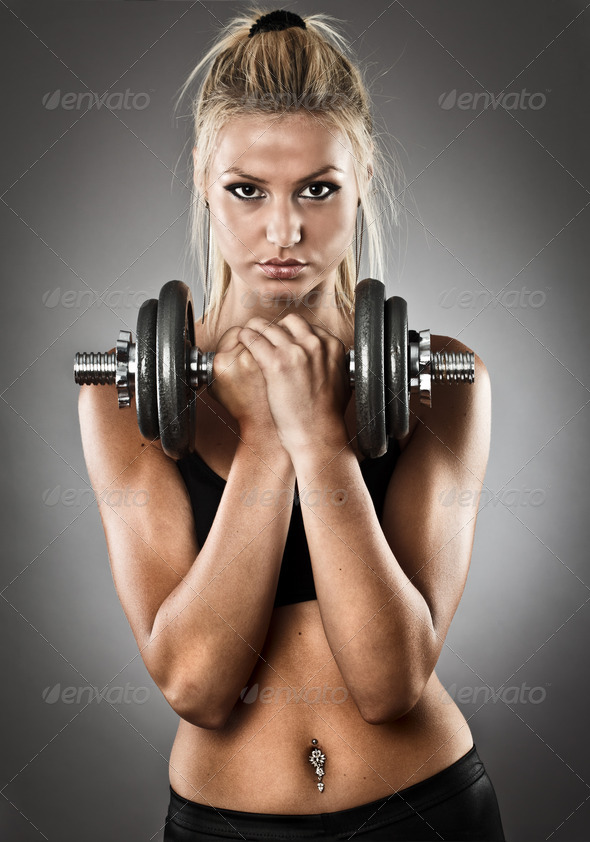 Young athletic woman doing workout - Stock Photo - Images