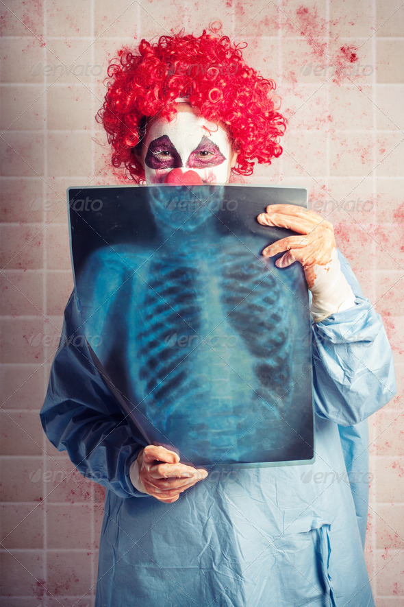 Scary clown peeking behind x-ray. Funny bones - Stock Photo - Images