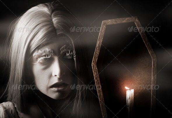Creepy vampire woman with light in ghost forest - Stock Photo - Images