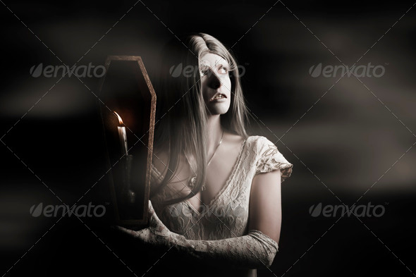 Spooky gothic girl in haunted horror house - Stock Photo - Images