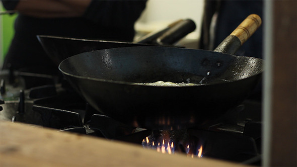 Cook Boiling in Black Pan