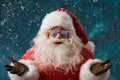 Santa Claus wearing sunglasses dancing outdoors at North Pole - PhotoDune Item for Sale